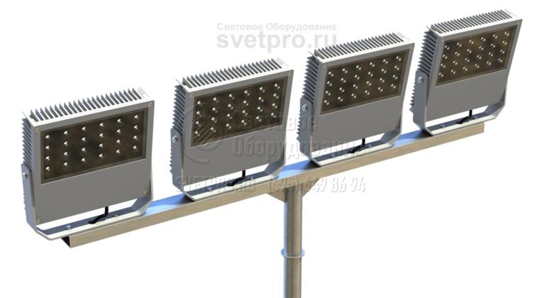 Прочность кронштейна позволяет устанавливать на нем 4 прожектора направленного света. Для этого удлиняется горизонтальная часть Т-образной детали. Для увеличения прочности соединительного узла он укрепляется треугольными косынками. Сборка изделия производится с помощь сварки.