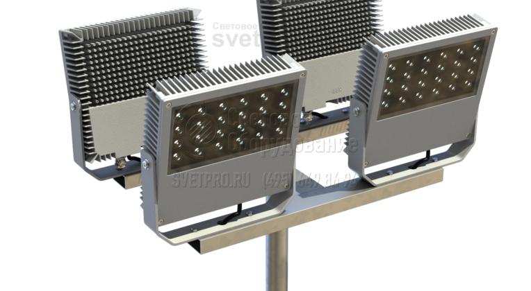 Одна из модификаций кронштейна под прожекторы — Н-образная модель. Такую форму имеет горизонтальный элемент изделия. Прожекторы на скобах крепятся попарно на каждом из параллельных элементов. Так создается яркое освещение с обеих сторон от опорной инженерной конструкции.